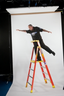 Phil taylor dropping dart from the top of a werner ladder