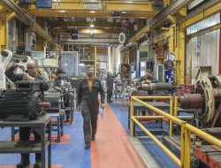 factory interior with workers at Fletcher-Moorland-industrial photo