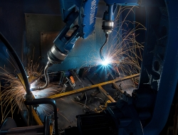 Welding image inside machine-Industrial photographs by ross vincent