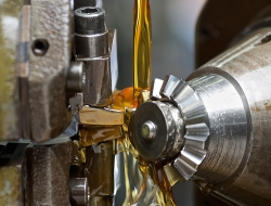 Machine detail with pouring oil-Industrial photo