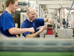 Packaging machine workers discuss production-Industrial photos