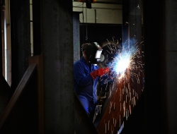 welder with large block of metal-industrial photographic image