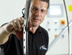 final preparation of precision aerospace component-industrial photographer