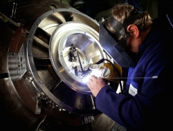 Arch welding on precision aerospace part-Industrial photographs