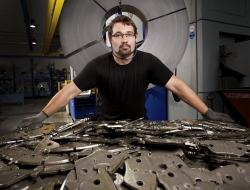 worker with components at Wild engineering Germany by ross vincent_industrial photography
