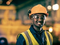 a Worker at Liberty Steel Newport with yellow hard hat and bib