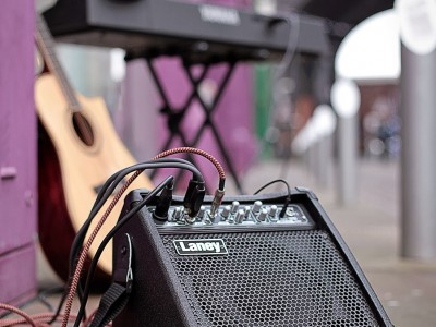 image of a portable guitar amplifier at the Custard factory Birmingham set up for busking with guitar and keyboard