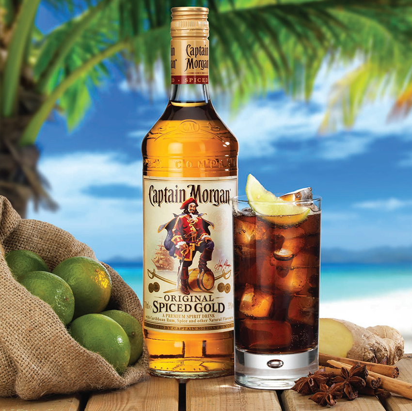 Advertising photograph of a captain Morgan rum bottle and glass served with ice and lemon product photography by Ross Vincent