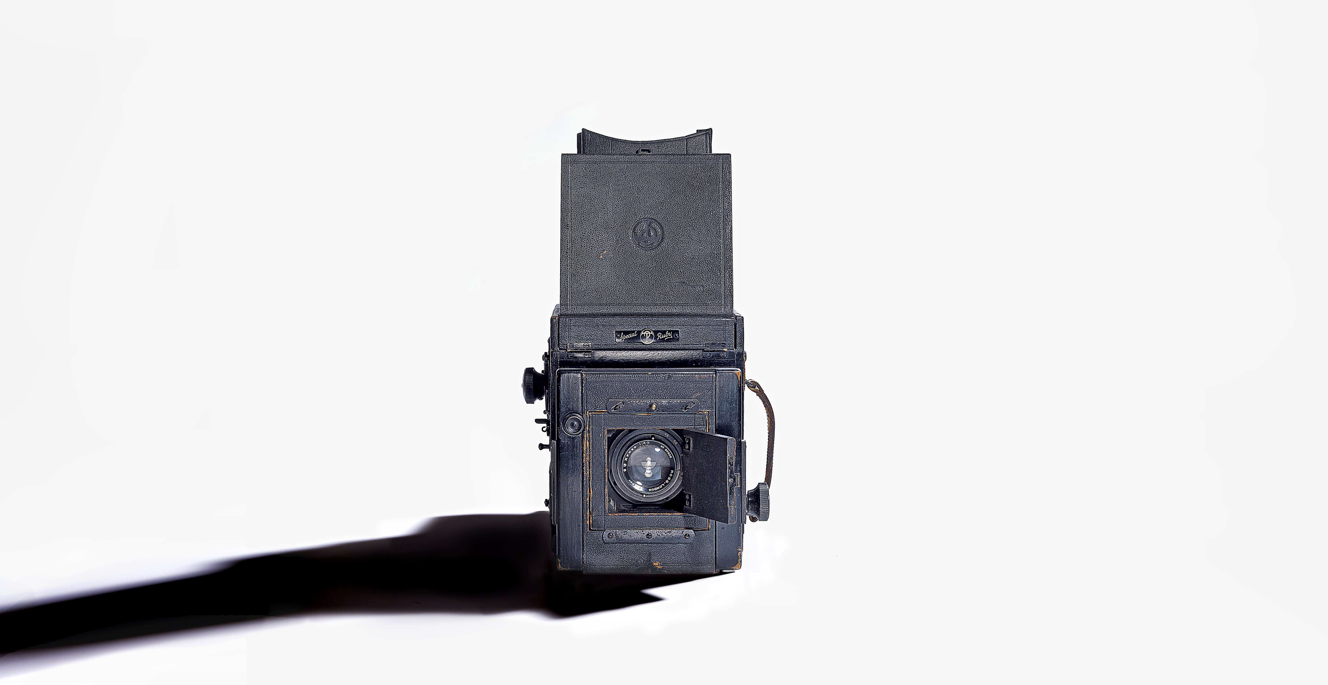 vintage camera with long shadow studio product photography by Ross Vincent-Birmingham
