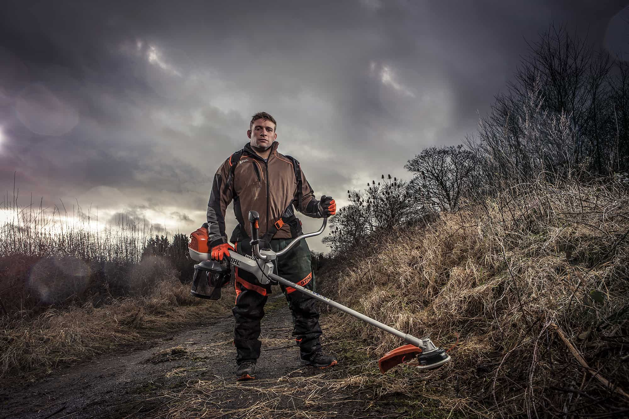 image of Tom youngs leicester Hooker using Stihl bush cutter tool location photography by ross vincent