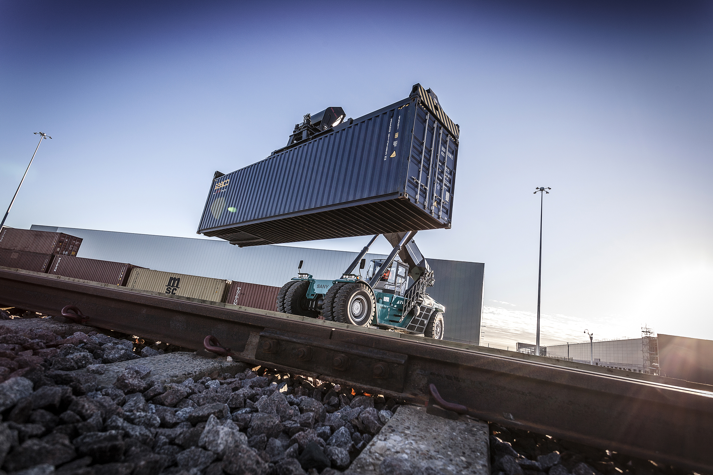 dramatic image of reach stacker by rail lines at the new Doncaster i-port terminal
