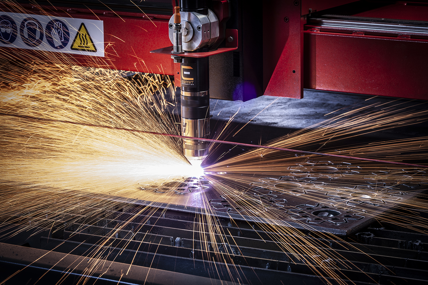 Dramatic photograph of plasma cutting metal with a shower of sparks